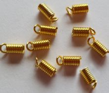 Coil Crimps Gold Plated x 10. approx 8mm x 3.5mm. For 2mm thong.